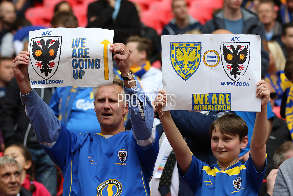 Wimbledon fans holding up banners. AFC Wimbledon promotion to League One, after beating Plymouth Argyle Football Club 2-0 during the Sky Bet League 2 play off final match between AFC Wimbledon and Plymouth Argyle at Wembley Stadium, London, England on 30 May 2016. Photo by Stuart Butcher.