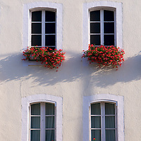Geraniums in windowboxes in the town of Joigny.
