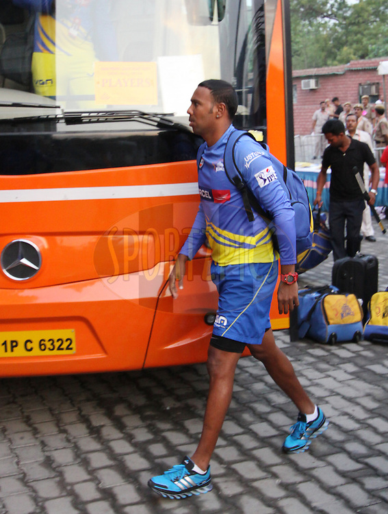 Dwayne Bravo of The Chennai Superkings arrive before  match 26 of the Pepsi Indian Premier League Season 2014 between the Delhi Daredevils and the Chennai Superkings held at the Ferozeshah Kotla cricket stadium, Delhi, India on the 5th May  2014<br /> <br /> Photo by Arjun Panwar / IPL / SPORTZPICS<br /> <br /> <br /> <br /> Image use subject to terms and conditions which can be found here:  http://sportzpics.photoshelter.com/gallery/Pepsi-IPL-Image-terms-and-conditions/G00004VW1IVJ.gB0/C0000TScjhBM6ikg