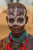 Kara tribe woman in their village high above the Omo River,  Omo Valley, Ethiopia.