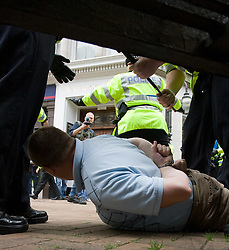 © Licensed to London News Pictures. 29/10/2011. Birmingham, UK. FILE PICTURE DATED 05/09/2009. Police detain a man during an English Defence League demonstration in September 2009. Photo credit : Joel Goodman/LNP