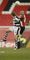 Photo: Aidan Ellis.<br /> Darlington v Swansea City. The FA Cup. 02/12/2006.<br /> Swansea's Darren Pratley beats Darlington's Michael Cummins in the air