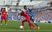 Blackburn Rovers player Modou Barrow shields the ball from Brighton defender full back Gaetan Bong during the Sky Bet Championship match between Brighton and Hove Albion and Blackburn Rovers at the American Express Community Stadium, Brighton and Hove, England on 22 August 2015. Photo by Bennett Dean.