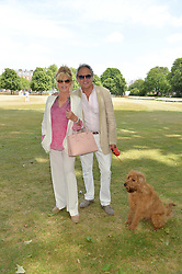 ROD & PATTIE WESTON and their dog Freddie at the Flannels For Heroes cricket competition in association with Dockers held at Burton Court, Chelsea, London on 19th June 2015