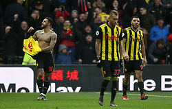 Watford's Andre Gray (left) celebrates scoring his side's second goal of the game during the Premier League match at Vicarage Road, Watford.