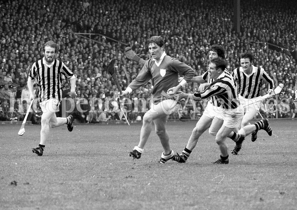974-8<br /> 'Got it!'...Limerick's Matt Ruth has the ball safely in his grasp as he is challenged by Kilkenny's Fan Larkin and Pat Lawlor.<br /> September 1974.<br /> (Part of the Independent Newspapers Ireland/NLI collection.)