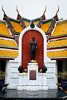 A statue of the King in military dress inside Wat Suthat in Bangkok, Thailand.