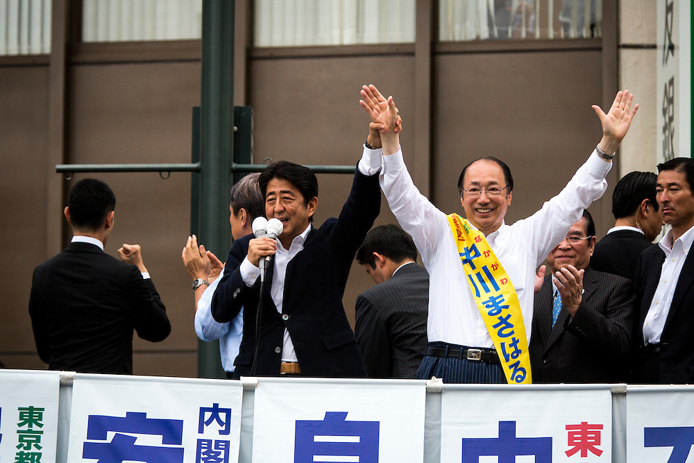 TOKYO, JAPAN - JULY 9 :  Japanese Prime Minister Shinzo Abe, president of the ruling Liberal Democratic Party (LDP), delivers a campaign speech to support candidate Masaharu Nakagawa during the last day the 2016 Upper House election campaign outside of Asakusa Station in Tokyo, Japan on July 9, 2016. Tomorrow, July 10, 2016 will be the first Upper house election nation-wide in Japan that 18 years old can vote after government law changes its voting age from 20 years old to 18 years old. (Photo by Richard Atrero de Guzman/NURPhoto)