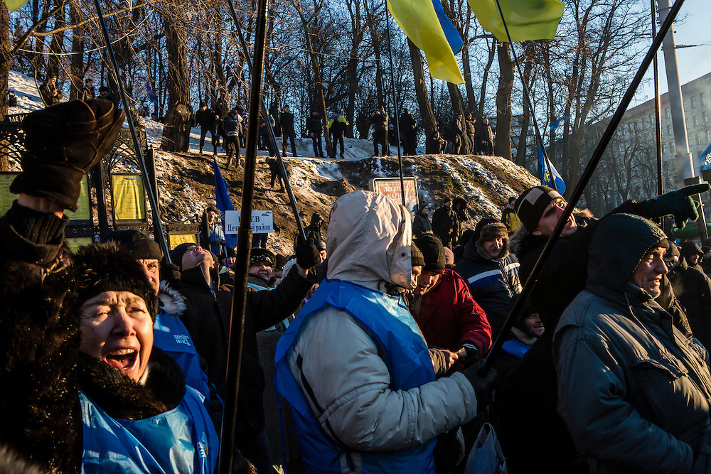 KIEV, UKRAINE - DECEMBER 14: A woman cheers at a pro-government rally held by Ukrainian President Viktor Yanukovych's ruling Party of Regions on December 14, 2013 in Kiev, Ukraine. Thousands of people have been protesting against the government since a decision by President Yanukovych to suspend a trade and partnership agreement with the European Union in favor of incentives from Russia. (Photo by Brendan Hoffman/Getty Images) *** Local Caption ***