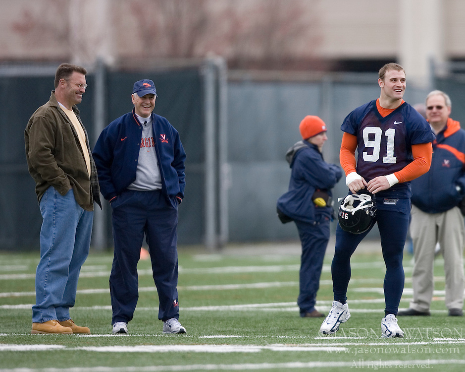 Howie Long (left) talks with Virginia Cavaliers Head Coach Al Groh while his son Virginia Cavaliers DE Chris Long (91) is at spring practice.  <br /> <br /> The Virginia Cavaliers football team opened their spring practice season on March 21, 2007 on the football practice fields behind University Hall in Charlottesville, VA.