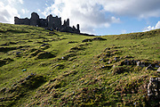 A group of adults and children walk up the steep incline towards Carreg Cennen Castle which sits at the top of a limestone cliff, Trapp, Brecon Beacons, Powys, UK. The castle has been in a ruinous state since 1462 and is under the care of Cadw, the Welsh Government historic environment service, however the estate is used as working farm land. (photo by Andrew Aitchison / In pictures via Getty Images)