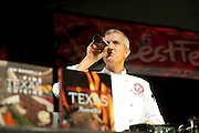 Jon Bonnell has a beer on stage while speaking during ZestFest at the Irving Convention Center on Saturday, January 26, 2013 in Irving, Texas. (Cooper Neill/The Dallas Morning News)