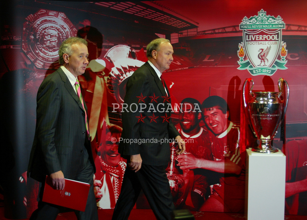 Liverpool, England - Tuesday, February 6th, 2007: Liverpool FC Chief-Executive Rick Parry walks into a press conference with American tycoons George Gillett (L) and Tom Hicks (R) after announcing their take-over of Liverpool Football Club in a deal worth around £470 million. Texan billionaire Hicks, who owns the Dallas Stars ice hockey team and the Texas Rangers baseball team, has teamed up with Montreal Canadiens owner Gillett to put together a joint £450m package to buy out shareholders, service the club's existing debt and provide funding for the planned new stadium in Stanley Park. (Pic by Dave Kendall/Propaganda)