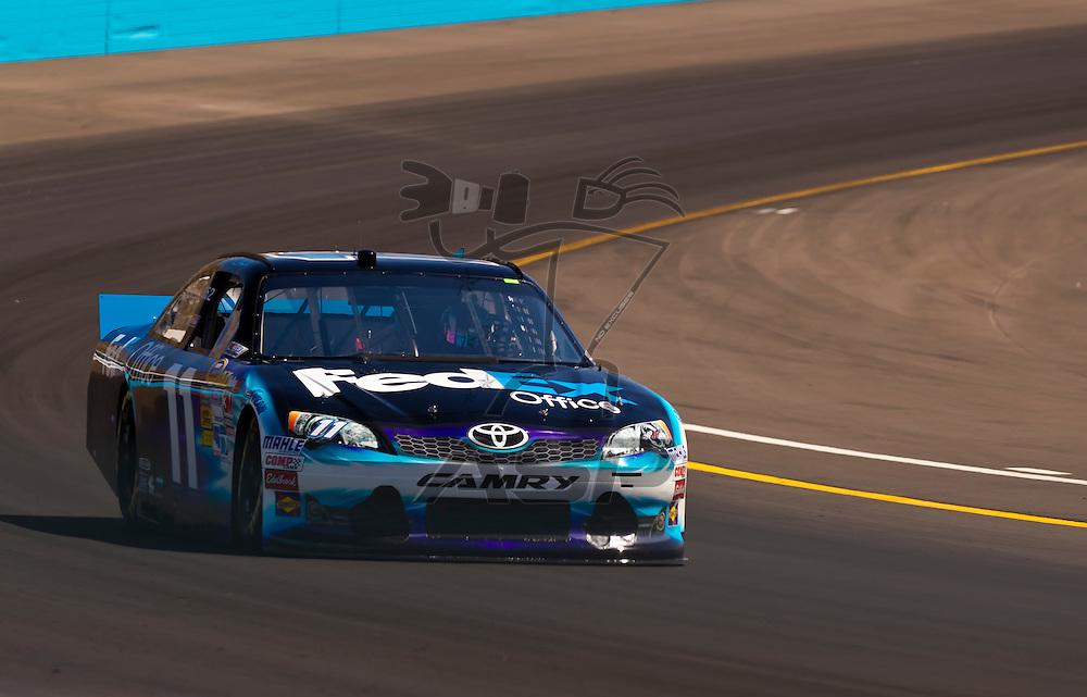 AVONDALE, AZ - MAR 03, 2012:  Denny Hamlin (11) brings his NASCAR Sprint Cup car through turn 4 during qualifying for the Subway Fresh Fit 500 race at the Phoenix International Raceway in Avondale, AZ.