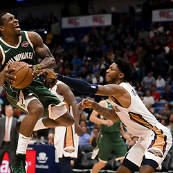 Mar 12, 2019; New Orleans, LA, USA; Milwaukee Bucks guard Eric Bledsoe (6) is defended by New Orleans Pelicans guard Elfrid Payton (4) during the second half at the Smoothie King Center. Mandatory Credit: Derick E. Hingle-USA TODAY Sports