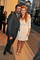 TREVOR PICKETT and AMBER NUTTALL at a party to celebrate the opening of luxury jewellers Nourbel & Le Cavelier first boutique in London in Burlington Arcade, London on 14th June 2012.