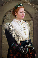 Julia, member of the Verein f&uuml;r Heimat- und Brauchtumspflege Geldersheim e.V., is wearing an original traditional bridal costume from 1920 in Geldersheim, Upper Franconia in Germany on March 4th, 2017.<br /> <br /> The jewelry is in private ownership of the families, the dress and crown are owned by the association.<br /> <br /> This is a Werntaler tradtional costume from Geldersheim.<br /> <br /> This is part of the series about Traditional Wedding Gowns from different regions of Germany, worn by young members of local dance groups and cultural associations that exist to preserve and celebrate the cultural heritage. The portraiture series is a depiction of an old era with different social values and religious beliefs in an antiquated civil society with very few of those dresses left.