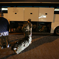 A soldier gets ready to load her bag onto the bus Tuesday morning in Tupelo as members of the 155th Headquarters Headquarters Company leave for Fort Bliss to begin their deployment to the Middle East with the 155th Brigade Combat Team.
