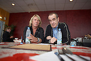 Rick Parfitt and Francis Rossi of  Status Quo relax in canteen while on the road during European tour in Lille, France. .