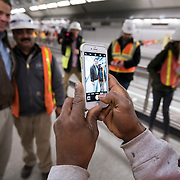 December 12, 2016 - New York, NY :  New York State Governor Andrew M. Cuomo, left, poses for a photo with a worker as he passes through the 72nd Street Second Avenue subway station on Monday morning. After years of delays, the new second avenue subway line is nearing completion. The governor visited the soon-to-open second avenue subway project on Monday morning with this photographer and New York Times reporter Emma G. Fitzsimmons.  CREDIT: Karsten Moran for The New York Times