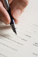 Man signing document close up of pen in hand