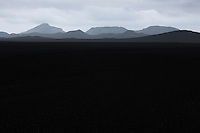 Black sands and mountains west of Veiðivötn, in the interior of Iceland.
