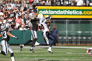 OAKLAND, CA - OCTOBER 10: Nnamdi Asomugha #21 of the Oakland Raiders defends the pass to Buster Davis #84 of the San Diego Chargers at Oakland-Alameda County Coliseum on October 10, 2010 in Oakland, California. (Photo by Tom Hauck) Player: Nnamdi Asomugha; Buster Davis