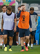 Jack Wilshere (L) and Wayne Rooney of England during the England training session the day before their final Group D match against Costa Rica at Mineirão, Belo Horizonte, Brazil. <br /> Picture by Andrew Tobin/Focus Images Ltd +44 7710 761829<br /> 23/06/2014