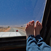 Toes of Shannon rolling down the long road on the way to Namibia.