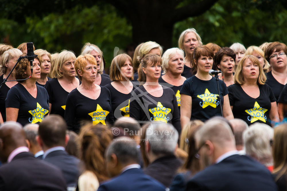 Hyde Park, London, July 7th 2015. Families of the victims and survivors of the 7/7 bombings in London gather at Hyde Park and are joined by the Duke of Cambridge Prince William at an emotional service commemorqating the Islamist terrorist bombing outrage that happened on London's transport network, claiming 57 lives and left scores of people injured. PICTURED: The Rock Choir performs during the ceremony.,