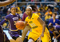 West Virginia Mountaineers guard Bria Holmes (23) drives down the lane against the TCU Horned Frogs at the WVU Coliseum.
