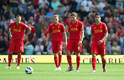 WEST BROMWICH, ENGLAND - Saturday, August 18, 2012: Liverpool's Lucas Leiva, captain Steven Gerrard and Luis Alberto Suarez Diaz look dejected as West Bromwich Albion score the opening goal during the opening Premiership match of the season at the Hawthorns. (Pic by David Rawcliffe/Propaganda)
