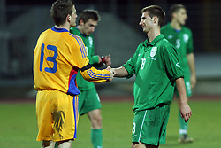 Silviu Ilie of Romania and Danijel Marceta (18)  of Slovenia after Friendly match between U-21 National teams of Slovenia and Romania, on February 11, 2009, in Nova Gorica, Slovenia. (Photo by Vid Ponikvar / Sportida)