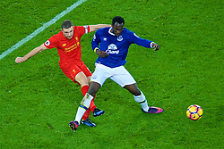LIVERPOOL, ENGLAND - Monday, December 19, 2016: Liverpool's captain Jordan Henderson in action against Everton's Romelu Lukaku during the FA Premier League match, the 227th Merseyside Derby, at Goodison Park. (Pic by Gavin Trafford/Propaganda)