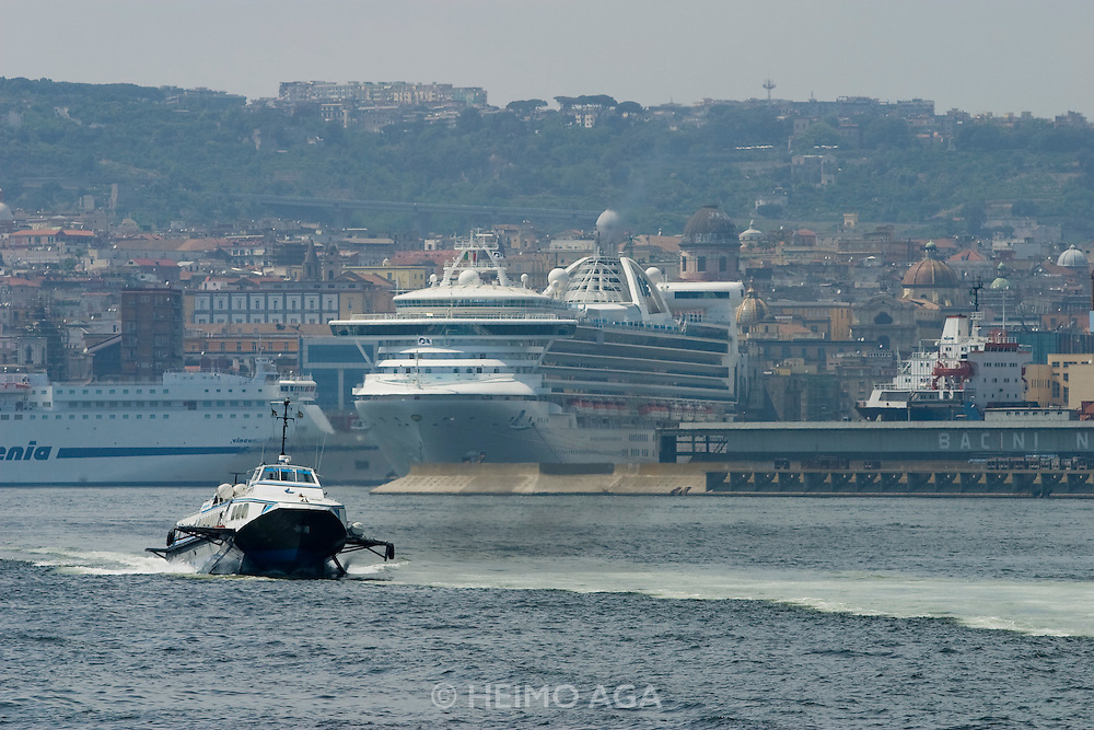 Cruise ships, ferries and hydrofoils at the harbour, seen from aboard the hydrofoil to Capri.