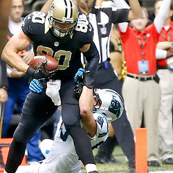 Dec 8, 2013; New Orleans, LA, USA; New Orleans Saints tight end Jimmy Graham (80) scores a touchdown past Carolina Panthers middle linebacker Luke Kuechly (59) during the first half of a game at Mercedes-Benz Superdome. Mandatory Credit: Derick E. Hingle-USA TODAY Sports