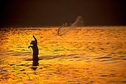 Image of a man fishing in Zihuatenejo, Mexico