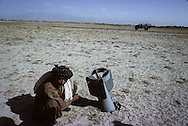 Afghanistan. With the mudjahidines in Paktia province in August 1979. unexploded bomb / The city of Zermat destroyed during the fighting beetween the moudjahidines and the  communist troups of Taraki;  / destruction, dead bodies, tanks, airplane, bombs / the rebelion near Gardez,   Paktia  Afghanistan   /la rebelion pres de Gardez; la ville de Zermat detruite a la suite des combats contre le gouvernement communiste de Taraki / destructins, cadavres  Paktia  Afghanistan  /AFG26700 4