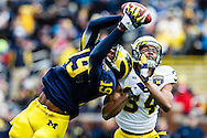 Apr 13, 2013; Ann Arbor, MI, USA; Michigan Wolverines tight end Devin Funchess (19) makes a catch over defensive back Jeremy Clark (34) during the Spring Game at Michigan Stadium. Mandatory Credit: Rick Osentoski-USA TODAY Sports