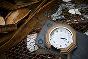 A clock lies among the debris in Otsuchi, Iwate Prefecture, Japan on 11 June, 2011. The clock shows the time that the tsunami hit the town. Authorities are unable to dispose of much of the debris created by the March disasters due to fears of radiation contamination, leading to giant mounds of waste that are becoming increasingly more toxic. The disaster is estimated to have left behind some 25 million tons of waste. Photographer: Robert Gilhooly
