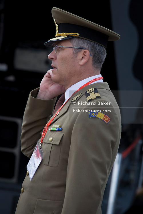 An unknown Romanian military official makes a phone call while on the Finmeccanica exhibition stand at the Farnborough Air Show, England.