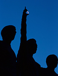 MANCHESTER, ENGLAND - Wednesday, March 16, 2016: The moon seen through the hand of a statue of former Manchester United players George Best, Dennis Law and Bobby Charlton outside Old Trafford stadium before the UEFA Europa League Round of 16 2nd Leg match between Manchester United and Liverpool. (Pic by David Rawcliffe/Propaganda)