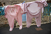 baby clothing hanging to dry
