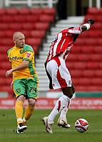 Photo: Paul Greenwood/Sportsbeat Images.<br />Stoke City v Norwich City. Coca Cola Championship. 01/12/2007.<br />Stoke's Mamady Sidibe, (R) beats the challenge of Matty Pattison