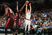 February 8, 2017: Dejan Vasiljevic #4 of Miami shoots over Ahmed Hill #13 of Virginia Tech during the NCAA basketball game between the Miami Hurricanes and the Virginia Tech Hokies in Coral Gables, Florida. The 'Canes defeated the Hokies 74-68.