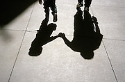 shadow of a father and son walking