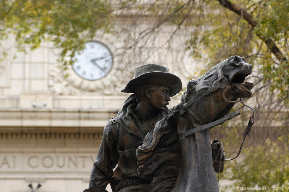 Cowboy statue and trees in front of courthouse, Prescott, Arizona