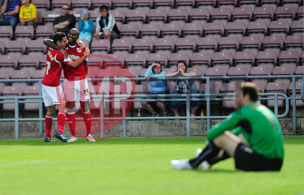 Bristol City's Marvin Elliott and Bristol City's Sam Baldock  celebrate  - Photo mandatory by-line: Dougie Allward/JMP - Tel: Mobile: 07966 386802 11/08/2013 - SPORT - FOOTBALL - Sixfields Stadium - Sixfields Stadium -  Coventry V Bristol City - Sky Bet League One