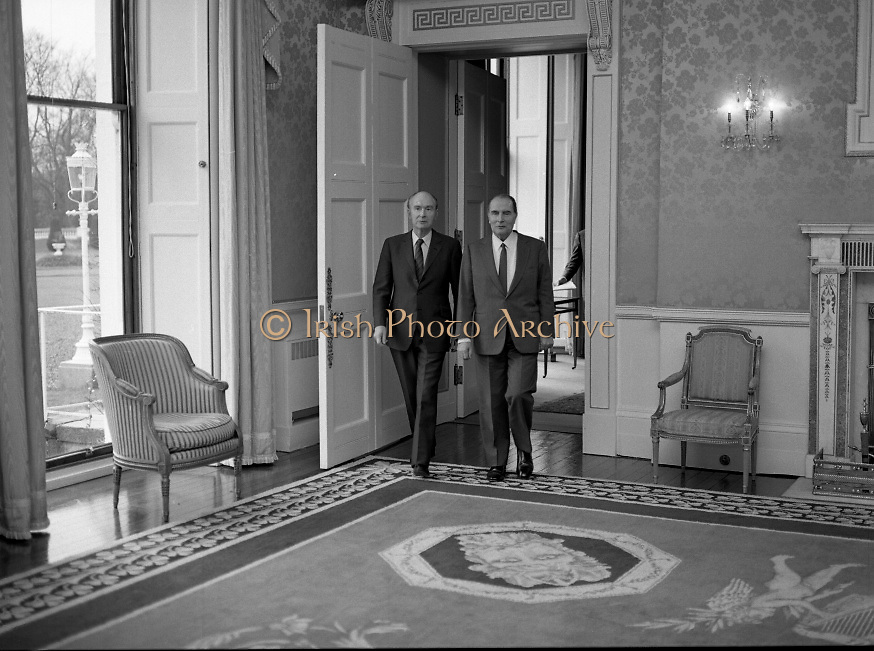 President Mitterand .at Áras an Uachtaráin..1984..21.02.1984..02.21.1984.21st February 1984..On a state visit to Dublin The French President, Mr Francois Mitterand,paid a visit to Áras an Uachtaráin,where he was greeted by The Irish President,Mr Patrick Hillery. ..Photograph of President Patrick Hillery as he leads President Mitterand into the Drawing room at Áras an Uachtaráin,Phoenix Park ,Dublin