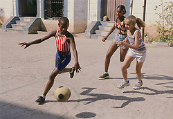 Group of children playing football outside,